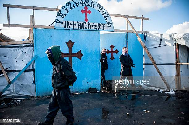 The deputy prefect of Pas de Calais Vincent Berton oversees the destruction of the jungle out of the church should be saved in Calais France on March...