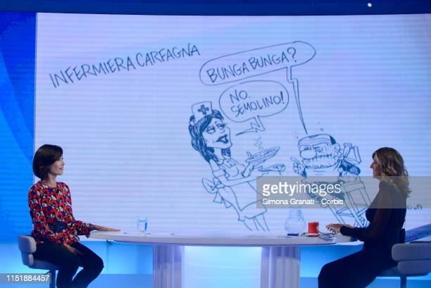The Deputy President of the Chamber of Deputies Mara Carfagna attends the television program L'Aria che Tirain front of a cartoon by Vauro on June 25...