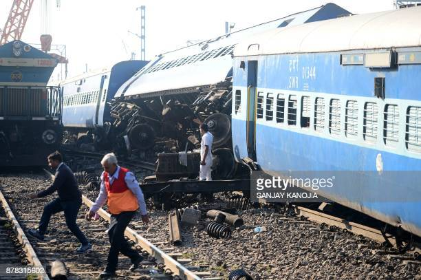 The derailed coaches of an Indian express train are pictured near Manikpur railway station in Uttar Pradesh on November 24 2017 Thirteen coaches of...