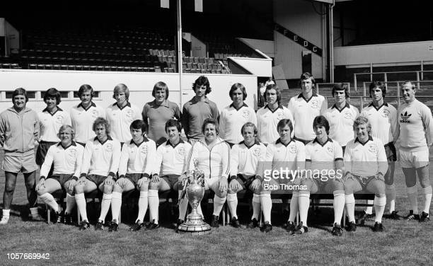 The Derby County squad pose for a team photograph with the League Championship trophy they won the previous season during a preseason photocall at...