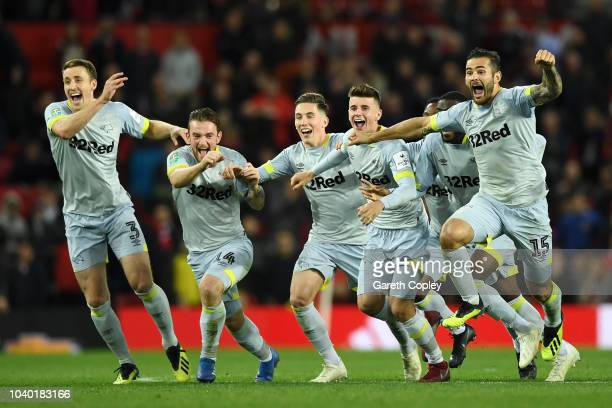 The Derby County team celebrate victory after a penalty shoot out in the Carabao Cup Third Round match between Manchester United and Derby County at...