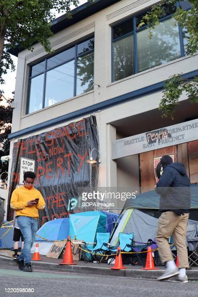 """The derelict Seattle East Precinct police station is seen inside the so-called """"Capitol Hill Autonomous Zone"""" in Seattle. The area surrounding..."""