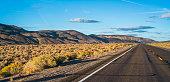 The desert highway in Nevada at sunset