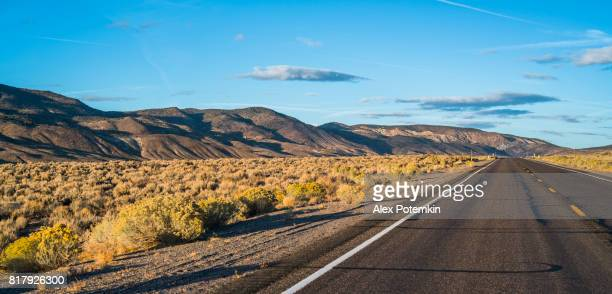 The desert highway in Nevada at sunset