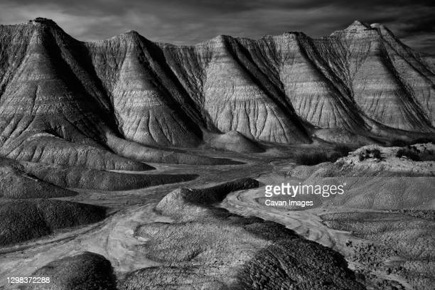 the desert landscape of the bardenas reales in navarra, spain - bedrock stock pictures, royalty-free photos & images