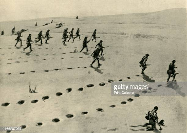 The Desert Phase of the SouthWest African Campaign Union Troops plodding forward under fire' First World War 'The photograph gives a good idea of the...