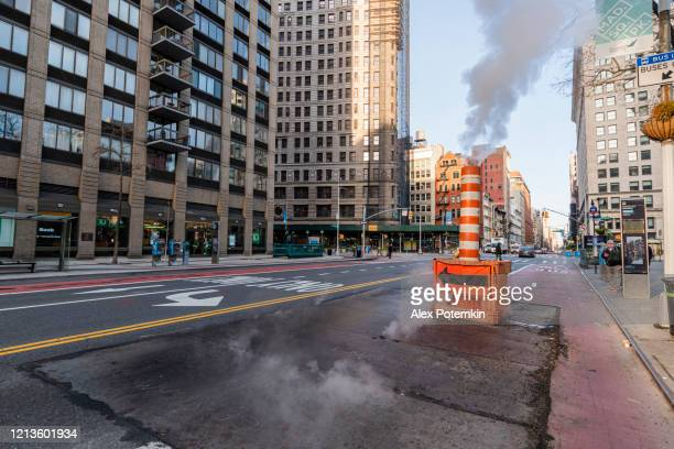 the deserted manhattan street during the covid-19 coronavirus outbreak - alex potemkin coronavirus stock pictures, royalty-free photos & images