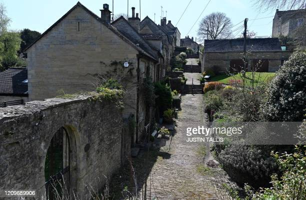 The deserted tourist attraction The Chipping Steps lined with cottages are pictured in the Cotswolds village of Tetbury western England on April 11...