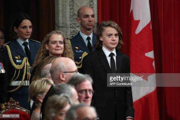 The Designate Governor general Julie Payette and her son Laurier Payette Flynn stand in the Senate in Ottawa, Ontario, October 2, 2017. Former...