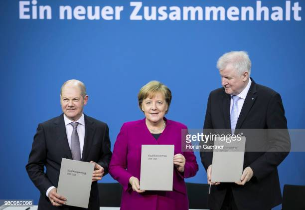 The designated German Finance Minister Olaf Scholz German Chancellor Angela Merkel and the designated German Interior Minister Horst Seehofer hold...