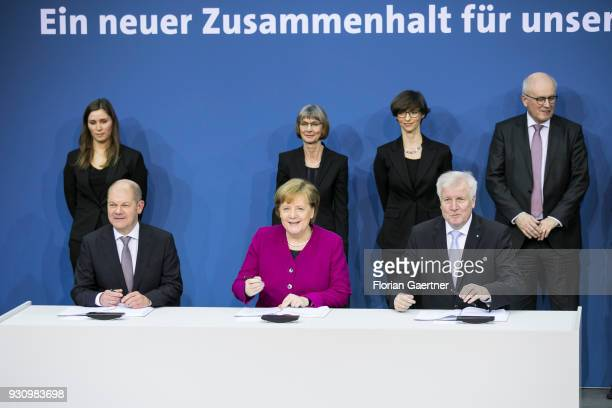 The designated German Finance Minister Olaf Scholz German Chancellor Angela Merkel and the designated German Interior Minister Horst Seehofer are...