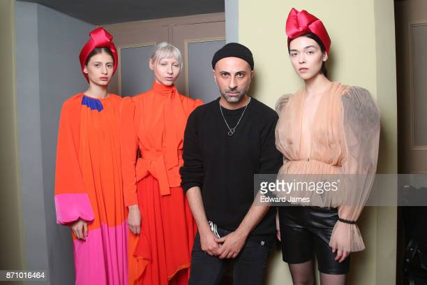 The designer Besarion Razmadze poses backstage during the Bessarion fashion show at MercedesBenz Fashion Week Tbilisi on November 6 2017 in Tbilisi...