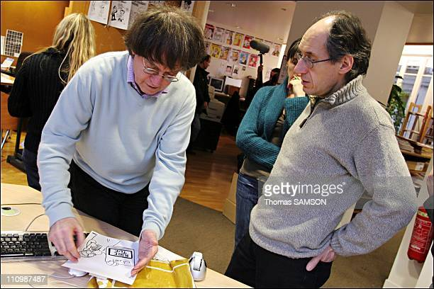 The designer Cabu and Gerard Biard, editor in chief at the time of the choice of the weekly in Paris, France on February 5th, 2007