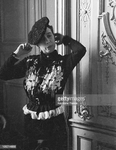 The Designer Elsa Schiaparelli Adjusting Her Hat In Her Offices At The Place Vendome In Paris In 1935
