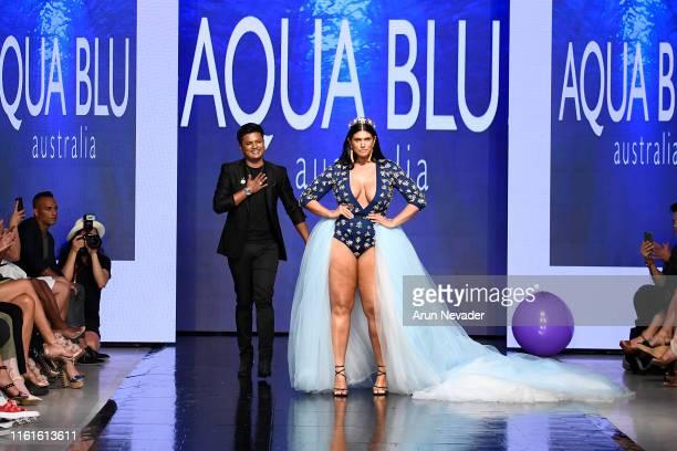 The designer for Aqua Blu walks the runway with a model for AQUA BLU SWIM At Miami Swim Week Powered By Art Hearts Fashion Swim/Resort 2019/20 at...
