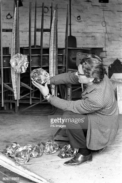 The designer John Hayward holds up a giant crystal which will be part of the four ton steel crown to be erected above the High Altar of Blackburn...