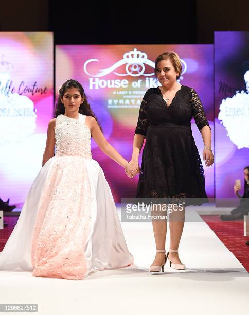 The designer Marie Belle walks the runway for Marie Belle Couture at the House of iKons show at the Millennium Gloucester Hotel on February 15 2020...