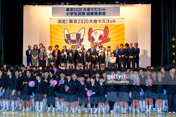 The designer of the characters chosen as mascots for Tokyo 2020 Ryo Tniguchi and Organising Committee President Yoshiro Mori pose with Committee...