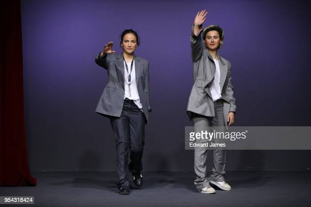 The designer sisters Nina Gvantsa Macharashviliwalk the runway during the Mach Mach fashion show at MercedesBenz Fashion Week Tbilisi on May 3 2018...