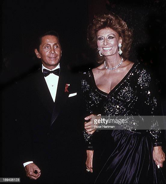 The designer Valentino Garavani with actress Sophia Loren at a Valentino party at the Park Avenue Armory New York New York 1992