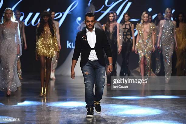 The designer walks the runway at the Yousef AlJasmi show during Dubai Fashion Forward April 2015 at Madinat Jumeirah on April 11 2015 in Dubai United...