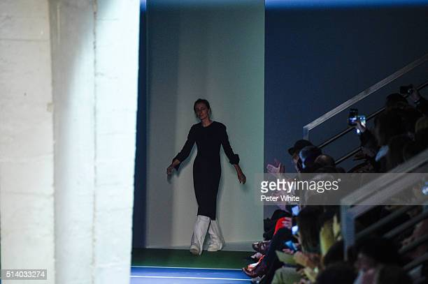The designer walks the runway during the Celine show as part of the Paris Fashion Week Womenswear Fall/Winter 2016/2017 on March 6 2016 in Paris...