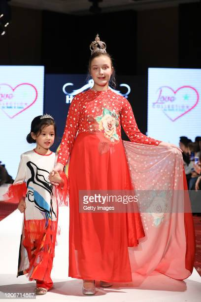 The designer walks the runway for Love Collection By Emily Anna at the House of iKons show at the Millennium Gloucester Hotel on February 16 2020 in...