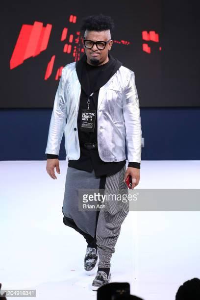 The designer walks the runway wearing CHINO' ARTE' BY WAYNE during NYFW Powered By hiTechMODA on February 08, 2020 in New York City.