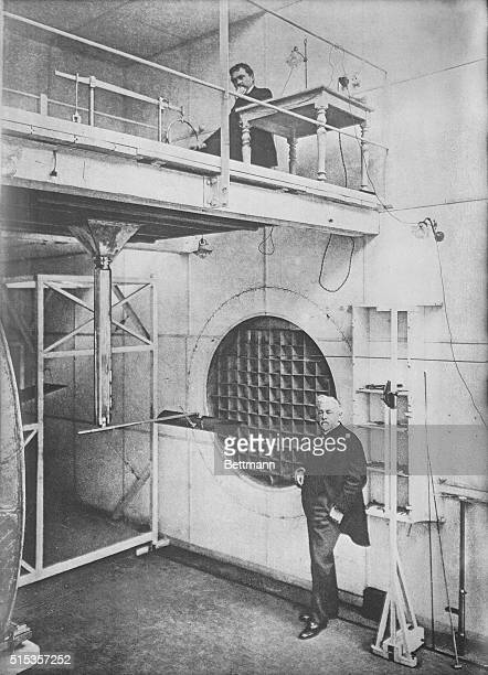 The designer-engineer of Paris' Eiffel Tower, Alexandre-Gustave Eiffel , standing beside a large wind tunnel.