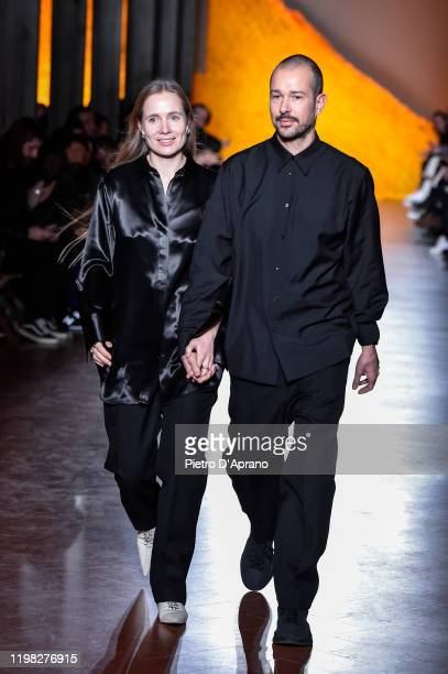The designers Lucie e Luke Meier walks the runway at the Jil Sander fashion show during Pitti Immagine Uomo 97 at Fortezza Da Basso on January 08,...