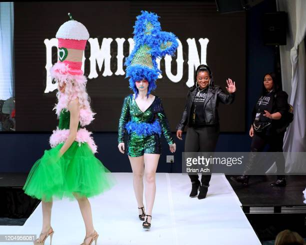 The designers walk the runway wearing Dominion Couture Costume Design during NYFW Powered By hiTechMODA on February 08, 2020 in New York City.