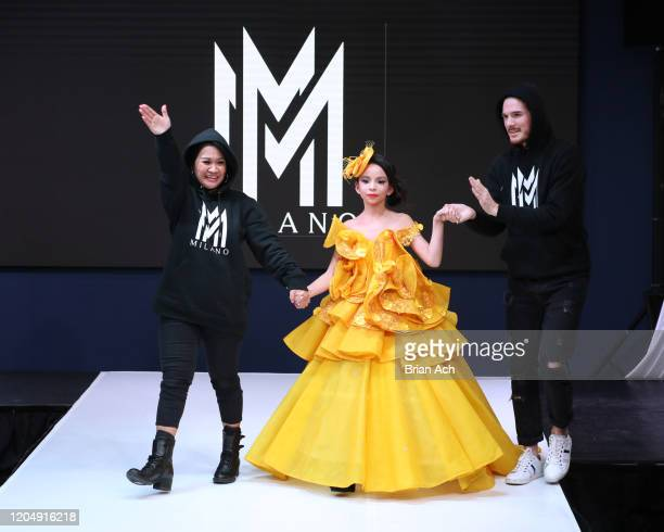 The designers walk the runway with a model wearing MM Milano Couture during NYFW Powered By hiTechMODA on February 08 2020 in New York City