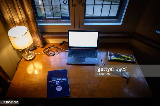 The desk area of a student is seen as he takes a break from studying for his degree in physics via online learning sessions in his room in Gonville...