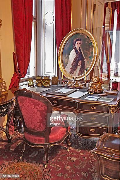 The desk of Emperor Franz Joseph with a portrait of the Empress Sissi in the Vienna Hofburg Vienna 2013 Photograph by Gerhard Trumler