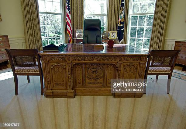The desk that US President George W Bush uses seen inside the Oval Office of the White House February 29 2008 in Washington DC AFP PHOTO/Paul J...