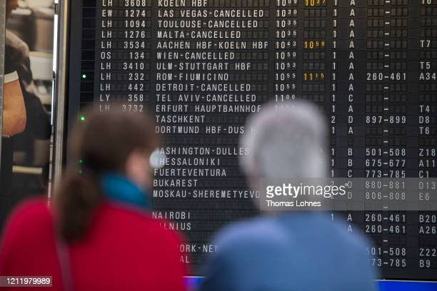 The destination board shows cancelled flights to America and Israel at Frankfurt Airport on March 12, 2020 in Frankfurt, Germany. U.S. President...