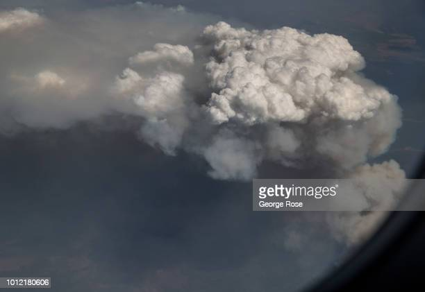 The destructive Carr Fire still burning out of control is viewed from a southbound Alaska Airlines commercial flight flying at 34000 feet on August 1...