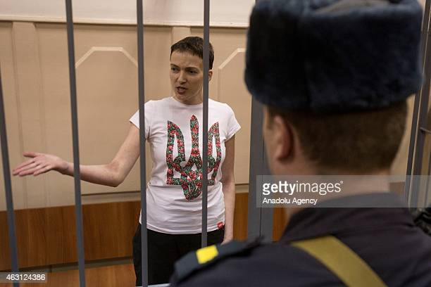 The detained Ukrainian pilot Nadia Savchenko who is held in detention in Russia stands inside the defendant's cage during her hearing in the Basmanny...