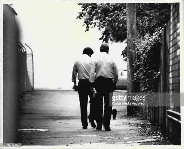 The detectives check the laneway beside the house in Pyrmont Bridge Road Glebe where a young woman was stabbed to death late last nightHe killer...