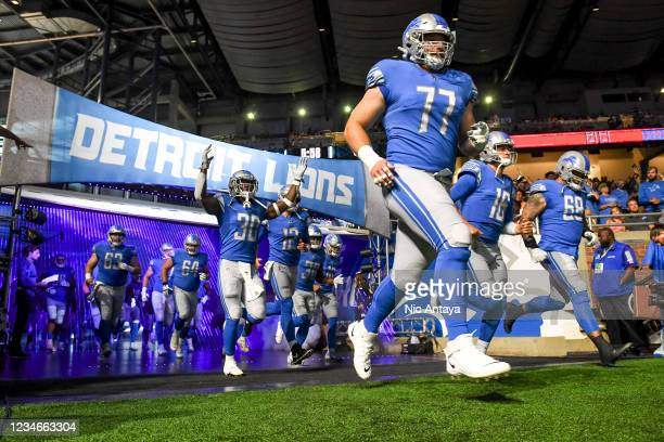 The Detroit Lions enter the field before a preseason game against the Buffalo Bills at Ford Field on August 13, 2021 in Detroit, Michigan.