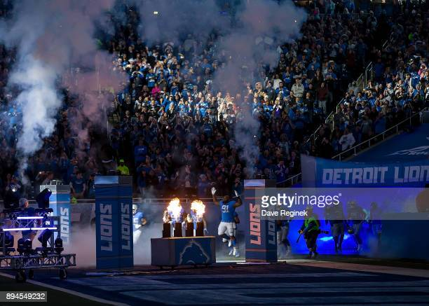 The Detroit Lions enter the field from the tunnel before an NFL game between the against the Minnesota Vikings at Ford Field on November 23 2016 in...