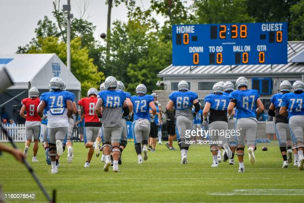 The Detroit Lions jog to their first practice station during the Lions Patriots joint training camp workouts on August 6 2019 at the Detroit Lions...