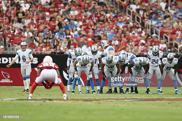 The Detroit Lions line up on the side as punter Sam Martin prepares to kick off to the Arizona Cardinals during the NFL game at the University of...