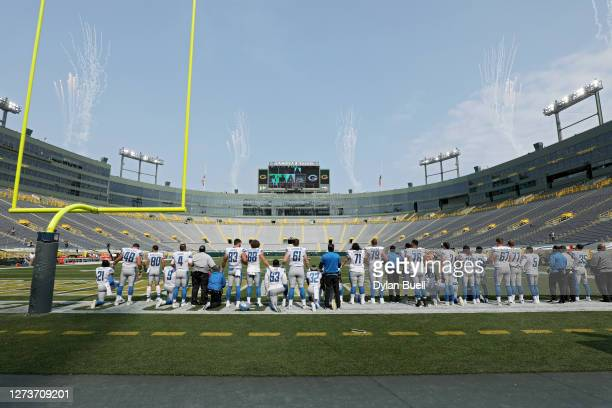 The Detroit Lions stand for the singing of the national anthem before the game against the Green Bay Packers at Lambeau Field on September 20, 2020...