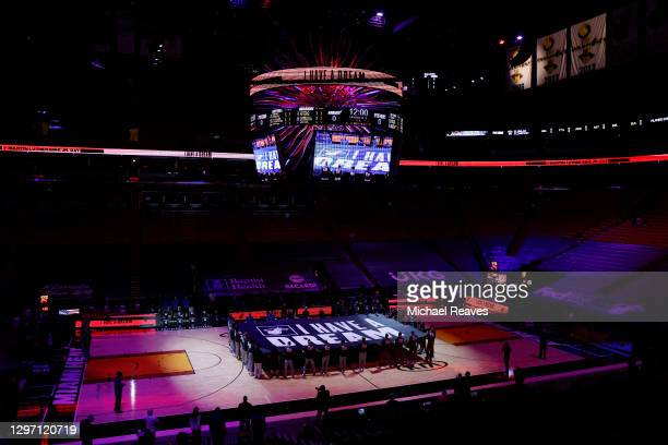 """The Detroit Pistons and the Miami Heat hold a """"I Have A Dream"""" banner to honor Martin Luther King Jr. Day during the playing of the national anthem..."""