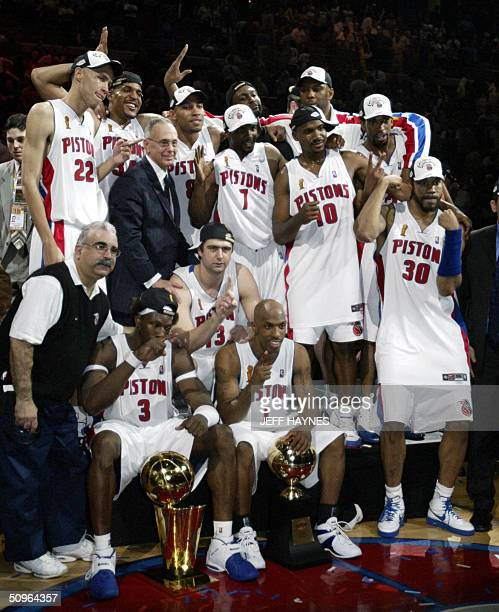 The Detroit Pistons celebrate as a team after beating the Los Angeles Lakers in game five of the NBA Finals to win the NBA championship 15 June, 2004...