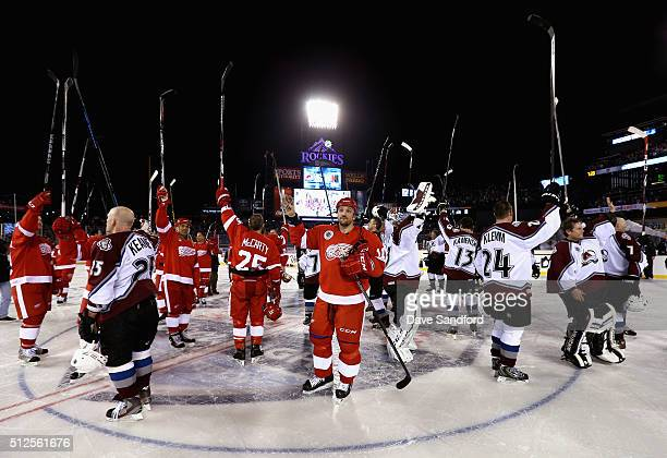 The Detroit Red Wings and Colorado Avalanche Alumni salute the fans after the 2016 Coors Light Stadium Series Alumni Game at Coors Field on February...