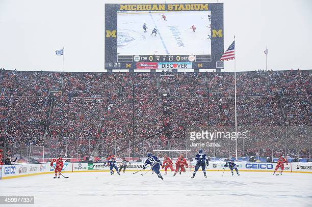 The Detroit Red Wings and the Toronto Maple Leafs play the first period during the 2014 Bridgestone NHL Winter Classic on January 1 2014 at Michigan...