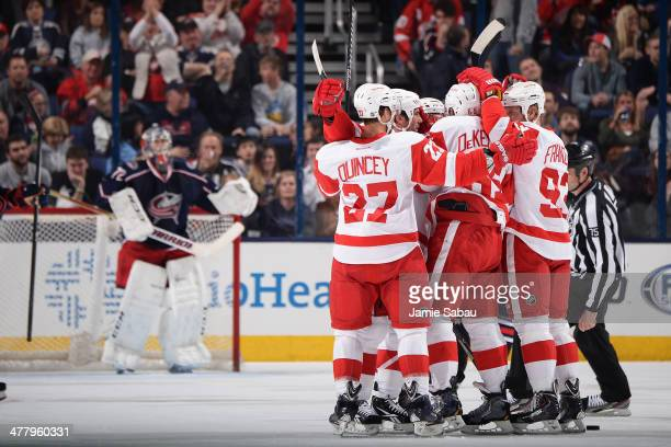 The Detroit Red Wings celebrate after scoring on goaltender Sergei Bobrovsky of the Columbus Blue Jackets during the first period on March 11 2014 at...