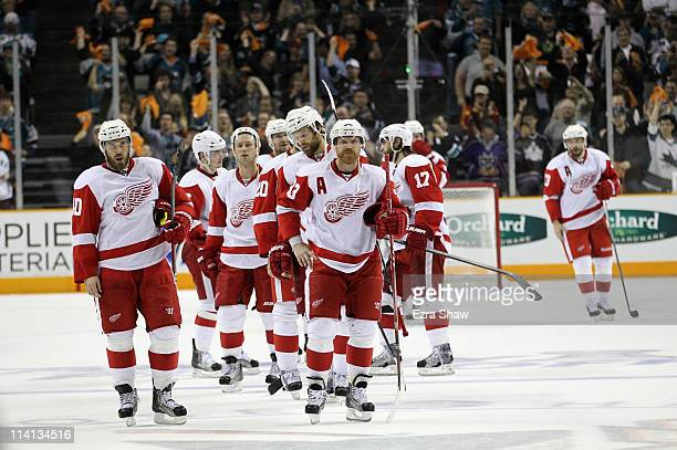 The Detroit Red Wings wait to shake hands with the San Jose Sharks after they lost Game Seven of the Western Conference Semifinals during the 2011...